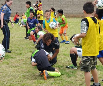 Graves Elementary students compete against SROs in soccer game