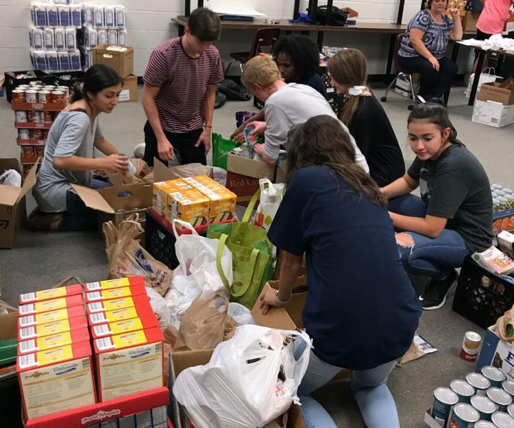 Friday Night Food Fights result in more that 64,000 pounds of food donations