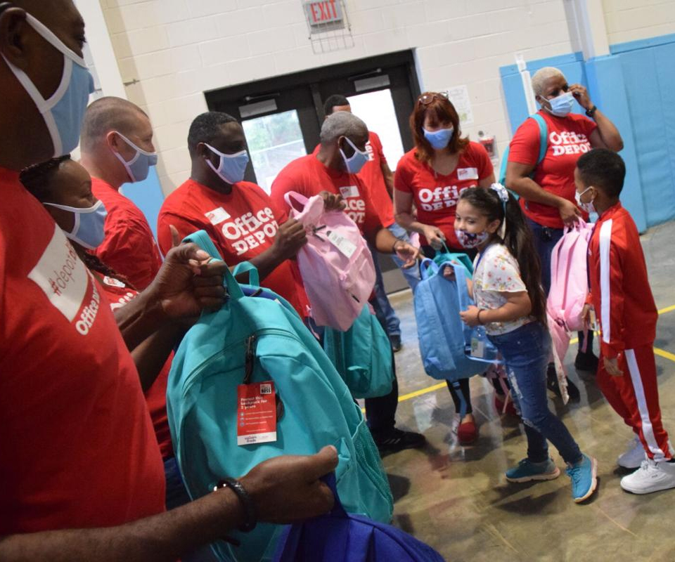 Office Depot donates 1,000 supplies-stuffed book bags to Meadowcreek Elementary School students