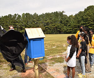 Local rotarians unveil 'Little Library' for Lawrenceville Elementary School students